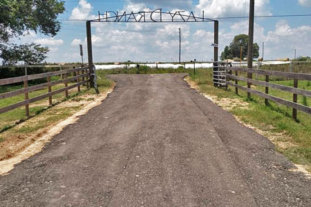 New asphalt driveway installation for horse farm in Florida.